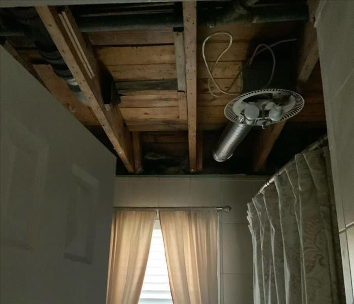 Exposed ceiling interior in bathroom