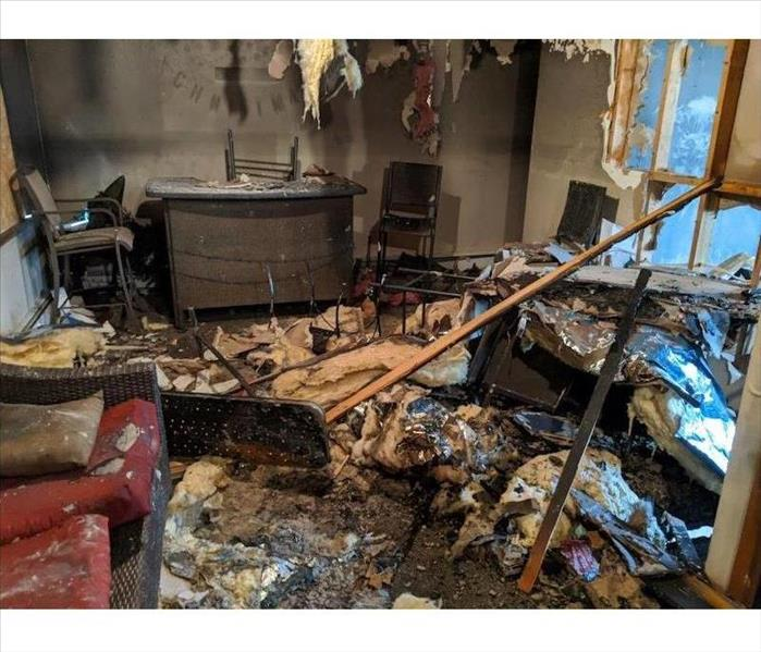 Room with fire damage and charred items