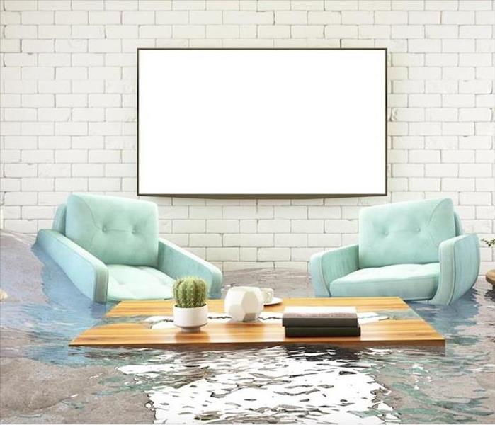 flooded room with two armchairs and small table