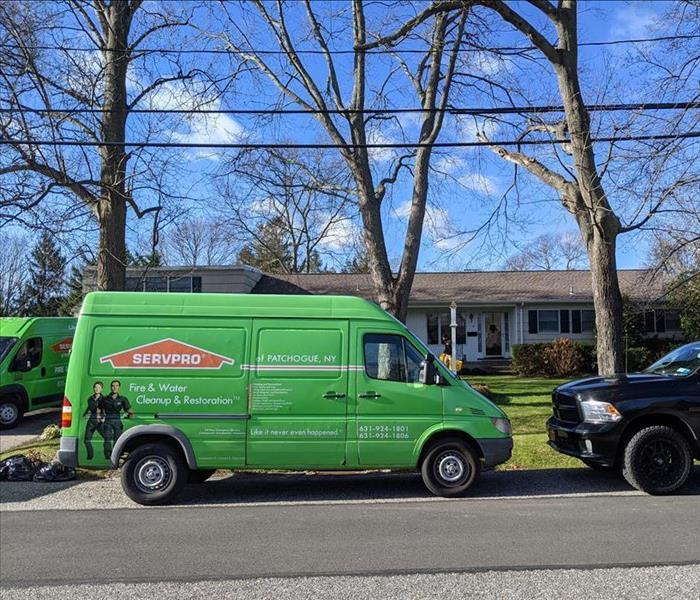 servpro green van parked in front of home
