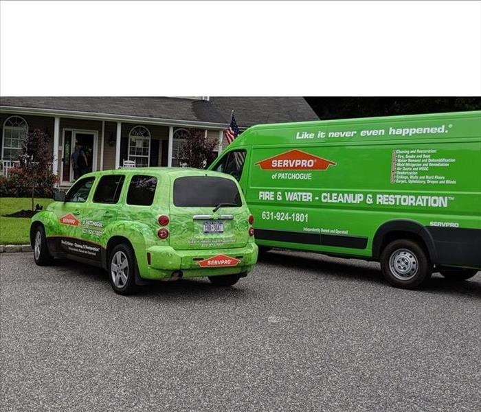 SERVPRO Green Service Vehicles Parked at a Job Site